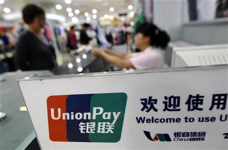 The logo of the China UnionPay is seen at a cashier at a shopping mall in Changzhi,